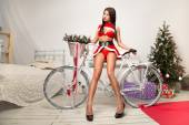 Sexually snow maiden with the bike — Stock Photo