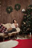 Girl on Christmas day with a Cup of tea — Stock Photo