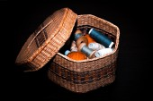 Basket with thread on black background — Stock Photo
