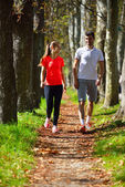 Young couple jogging in park — Stock Photo