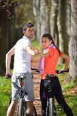 Young couple cycling — Stock Photo