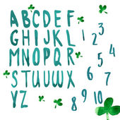 Green alphabet with clover leaves — ストックベクタ