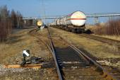 Railway tracks and a track switch, In the depths of the tank with fuel — Photo