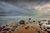 Coastline with concrete wave breaker. — Stock Photo