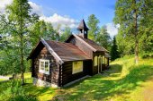 Stave church in small town — Stock Photo