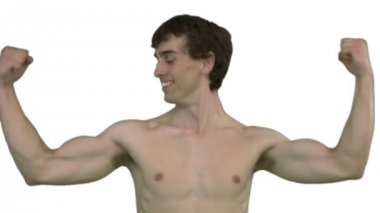 Young man showing off his muscles — Stock Video