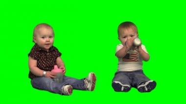 Baby twins drinking milk — Stock Video