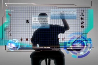 A man walks on screen and works on a futuristic floating-panel computer — Vídeo de stock