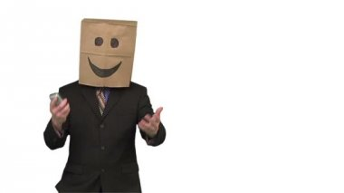Paperbag man using a cellphone — Stock Video