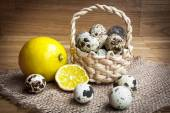 Quail eggs in a wooden basket — Stock Photo