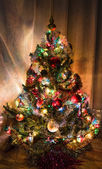 Christmas tree decorations, garlands and colorful lights — Stock Photo