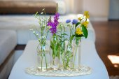 Glass vases with the flowers — Stock Photo