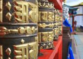 Prayer wheel in the meditative Buddhist temple — Stock Photo