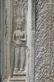 Stone mural on the walls of the castle in Cambodia — Stock Photo
