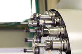 CNC industrial metal work bore cutting tool on automated lathe changer carousel — Stock Photo