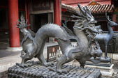 Bronze figures of a dragon and the deer - symbols of longevity a — Stock Photo