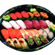 Set of sushi and rolls with a salmon — Stock Photo #63387933