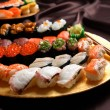 Set of sushi and rolls with a salmon — Stock Photo #75538419