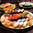 Set of sushi and rolls with a salmon — Stock Photo #75538445