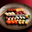 Set of sushi and rolls with a salmon — Stock Photo #75538593