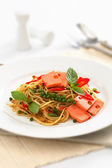 Fried Spaghetti with ham and sausage, Spicy fusion Thai food — Stock Photo