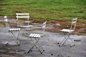Wet outdoor chair — Stock Photo