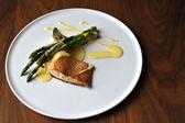 Baked salmon and asparagus — Stock Photo