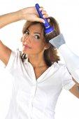 Woman blow drying hair — Stock Photo