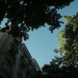 Classical Parisian apartment building and the Eiffel tower — Stock Video #61420491