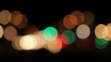 Blurred lights in different colors with black background. — Stock Video