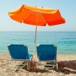 Blue sunbeds and orange umbrella (parasol) on Paradise Beach in  — Stock Photo #61642891