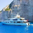 Luxury white yacht navigates into beautiful blue water near Zakynthos — Stock Photo #66647363
