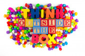 Thinkd outside the box word in colorful stone — Stock Photo