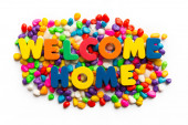 Welcome home word in colorful stone — Stock Photo