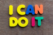 I can do it words in wood background — Stock Photo