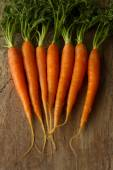 Delicious organic carrots on a brown background — Stock Photo
