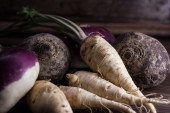 Root vegetables from the garden on a brown background — Stock Photo