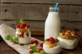 Yogurt for breakfast with nuts, raspberry and milk.  — Стоковое фото