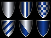 Shields in blue and silver colors — Stock Vector