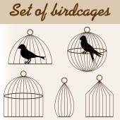 Set of birdcages with birds — Stockvector