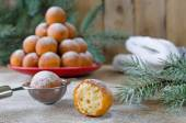 Christmas donuts with powdered sugar with fir branch — Stock Photo