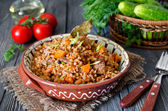 Buckwheat with meat and vegetables — Stock Photo