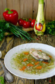 Homemade soup of fish and pearl barley — Stock Photo