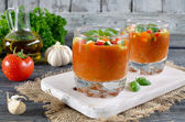 Fresh gazpacho on a wooden table — Stock Photo
