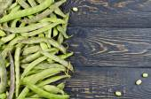 Green fresh soybeans on wood background — Stock Photo