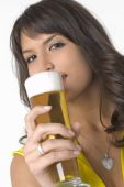Pretty girl drinking beer from the glass — Stock Photo