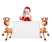 Santa and Reindeer with white board — Stock Photo