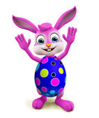 Easter Bunny with colourful eggs saying hi pose — Stock Photo