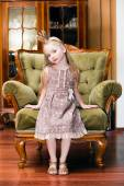 Little princess on a chair — Stock Photo