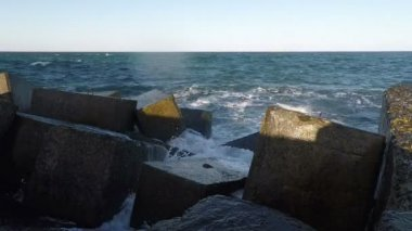 Surf and Rainbow at the Breakwater — Stock Video